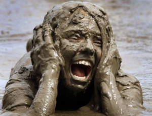 mud screaming woman