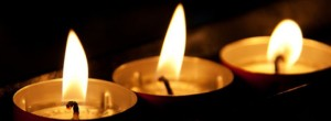 cropped-burning-candles-in-the-dark.jpg