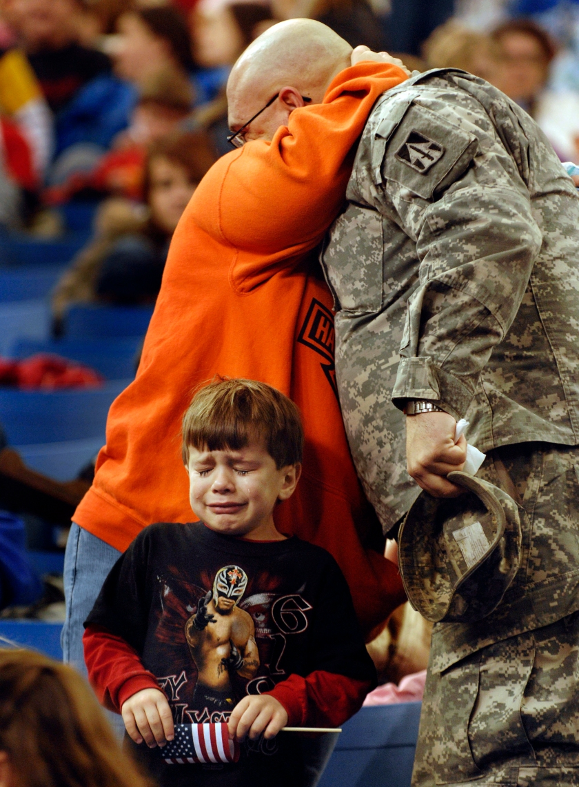 Sgt. Shane Pudgett hugs his wife goodbye as his son, Bryce, age 5, sheds a tear.