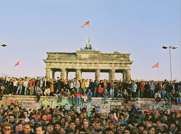 November 9, 1989, jubilant crowds celebrated the opening of border crossings along the Berlin Wall.