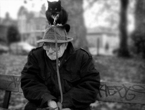 old man with cat on leash
