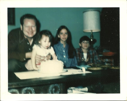 My Dad, brother and sister and me on my 2nd birthday. :)