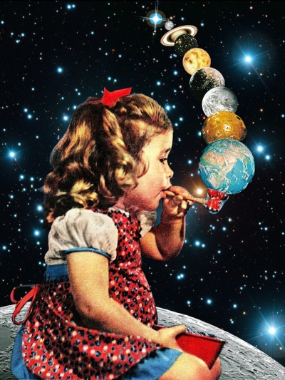 art girl blowing bubbles planets