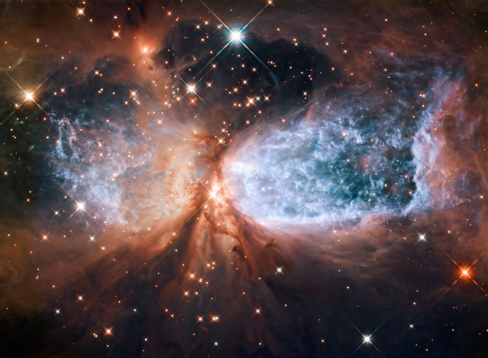 This image from the NASA/ESA Hubble Space Telescope shows Sh 2-106, or S106 for short. This is a compact star forming region in the constellation Cygnus (The Swan). A newly-formed star called S106 IR is shrouded in dust at the centre of the image, and is responsible for the the surrounding gas cloudÕs hourglass-like shape and the turbulence visible within. Light from glowing hydrogen is coloured blue in this image.