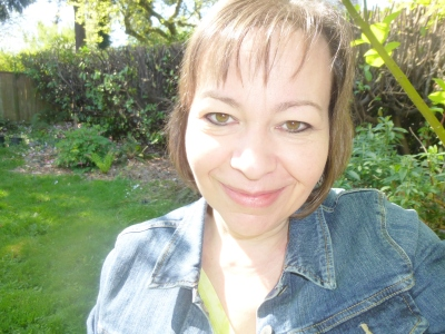 nancy in jean jacket back yard