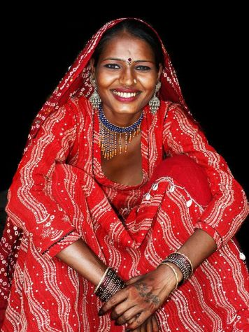 smile woman in red in india